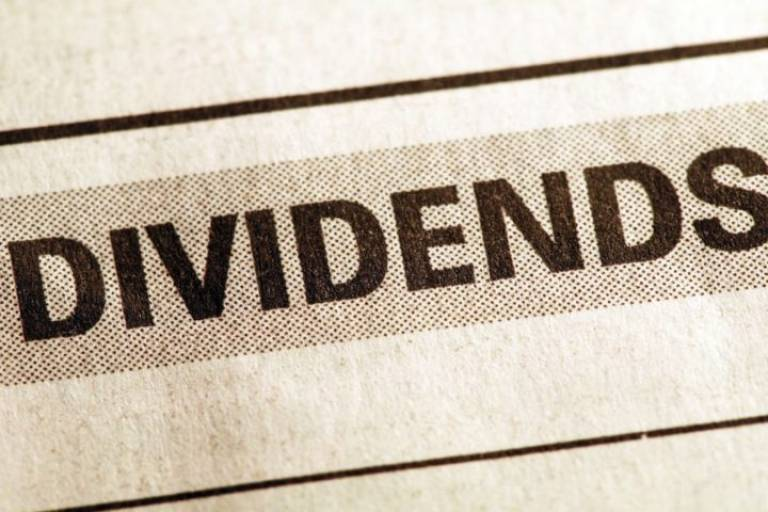Dividends financial section of newspaper